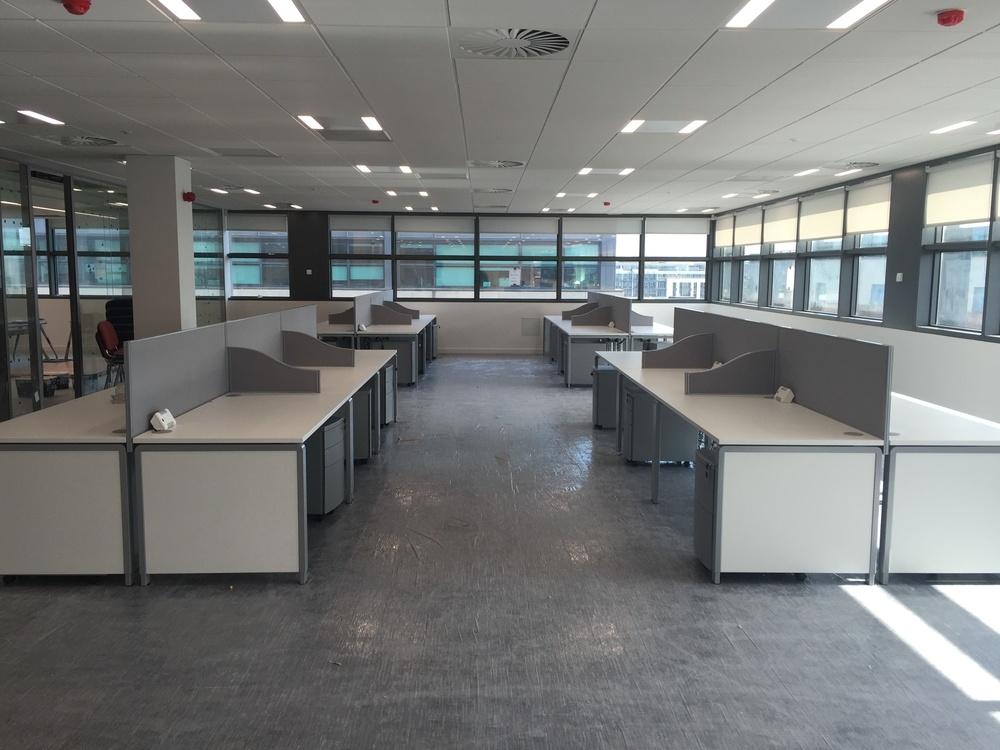 Row of desks and screens