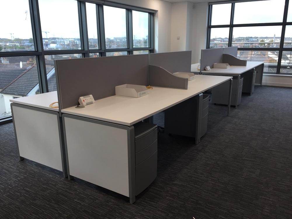 Bank of Ergo desks and screens