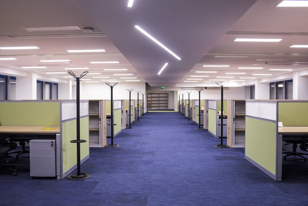 Corridor with desks and screens