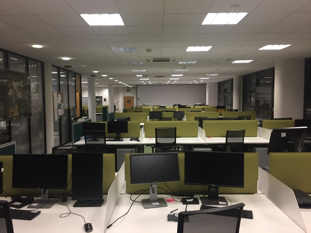 Open plan office with screens